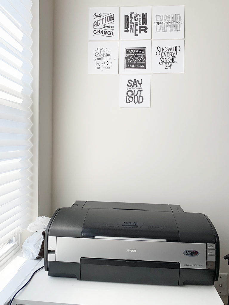 Large format photo printer setup and inspirational posters.