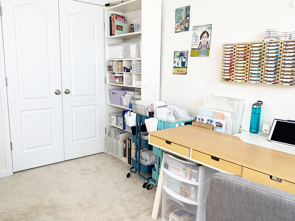 Scrapbooking desk, ink pad storage, bookshelf, and rolling carts.