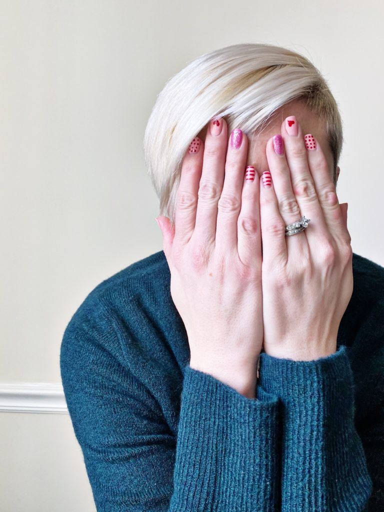photo of hands covering face