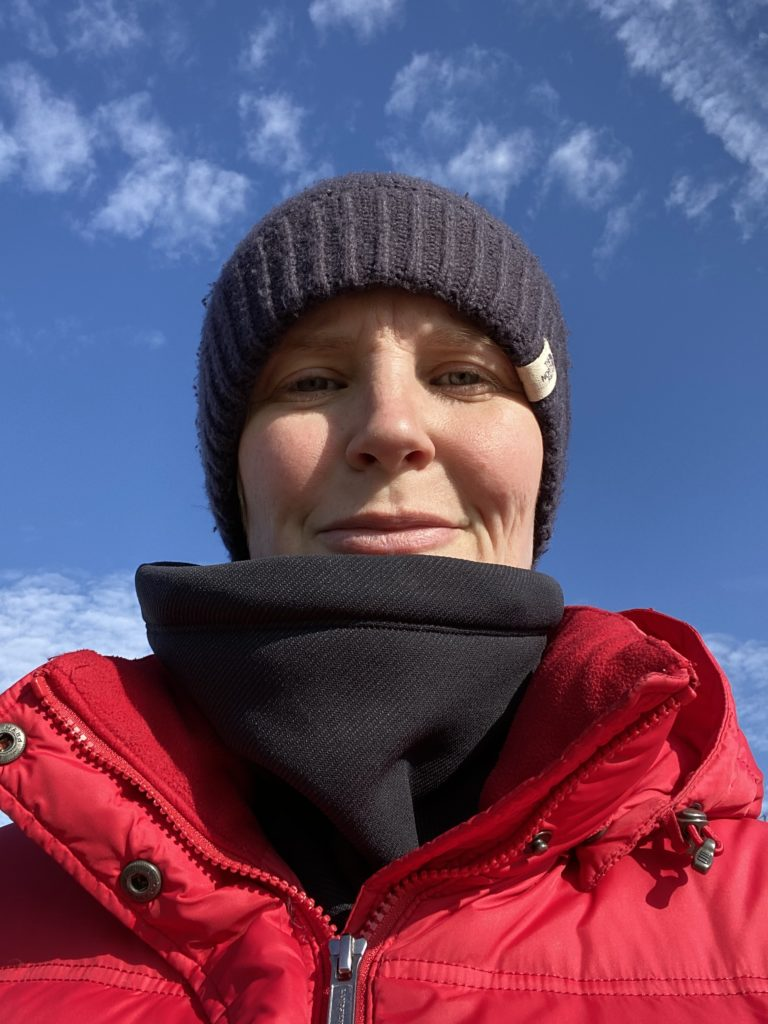 photo of my face in hat and coat with blue sky
