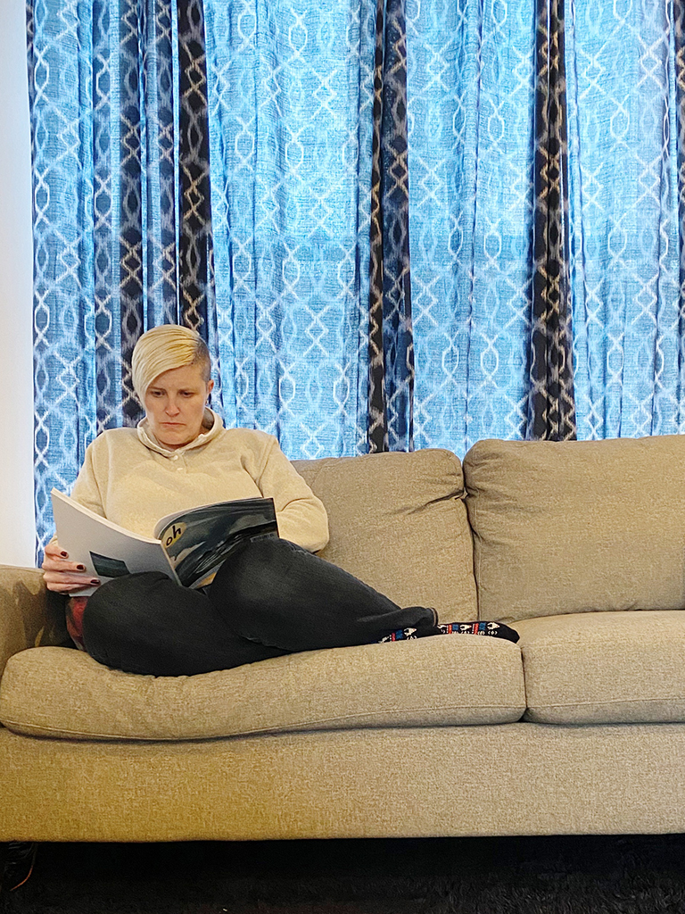 me sitting on the couch reading a magazine