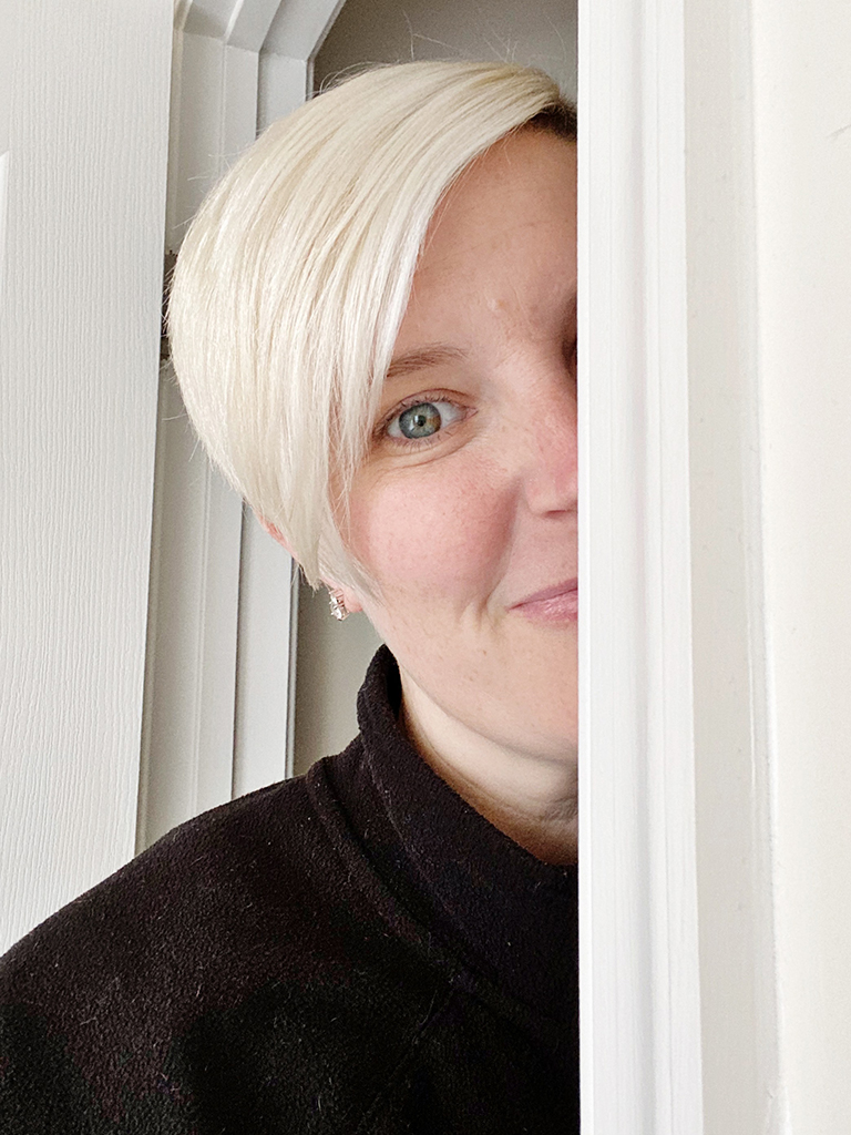 photo of my the right side of my face peering around a wall