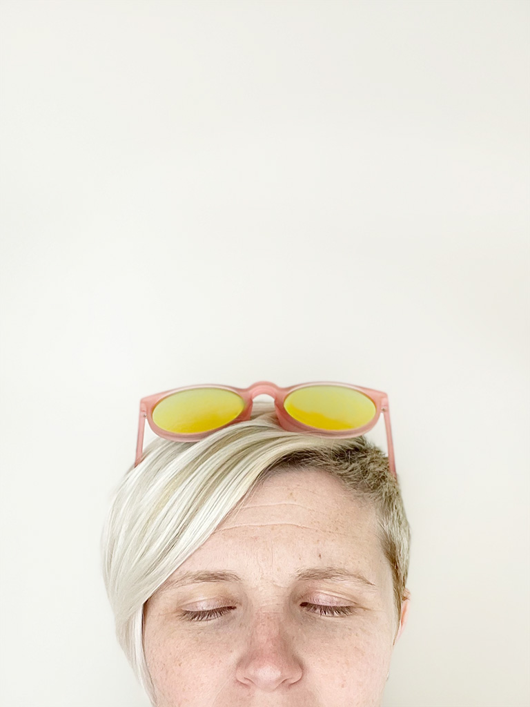 Author's head from nose up wearing sunglasses on top of head