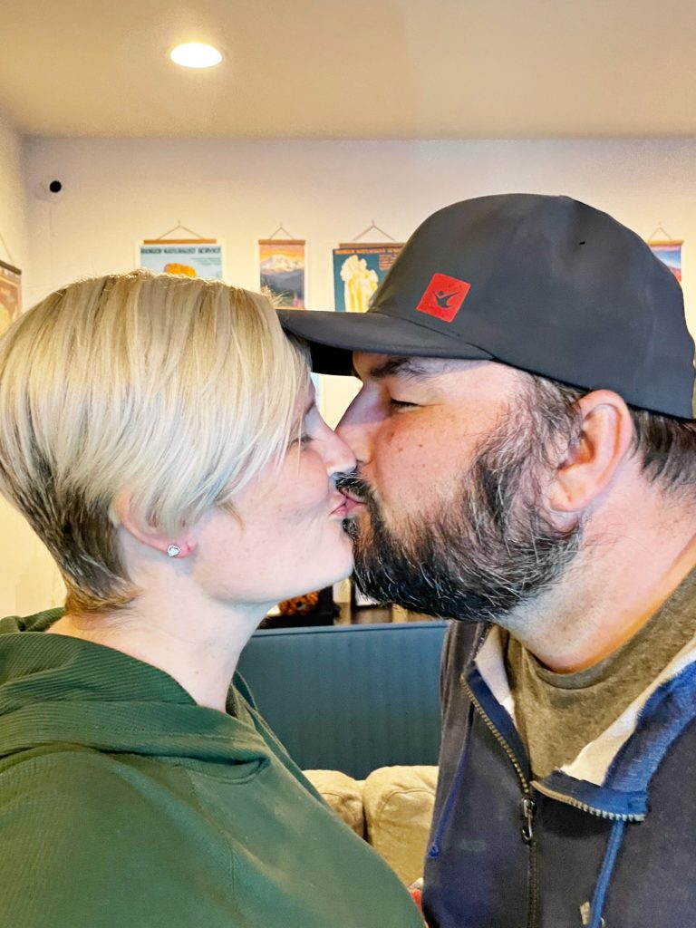 Author kissing her husband