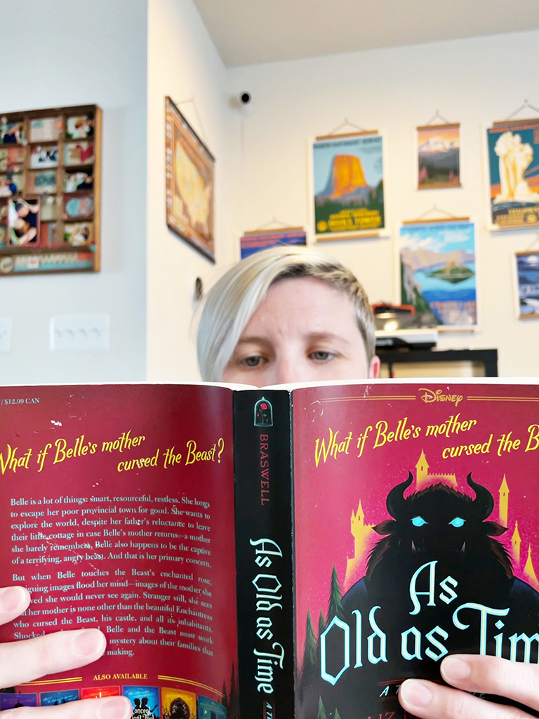 Top of author's head visible behind an open book