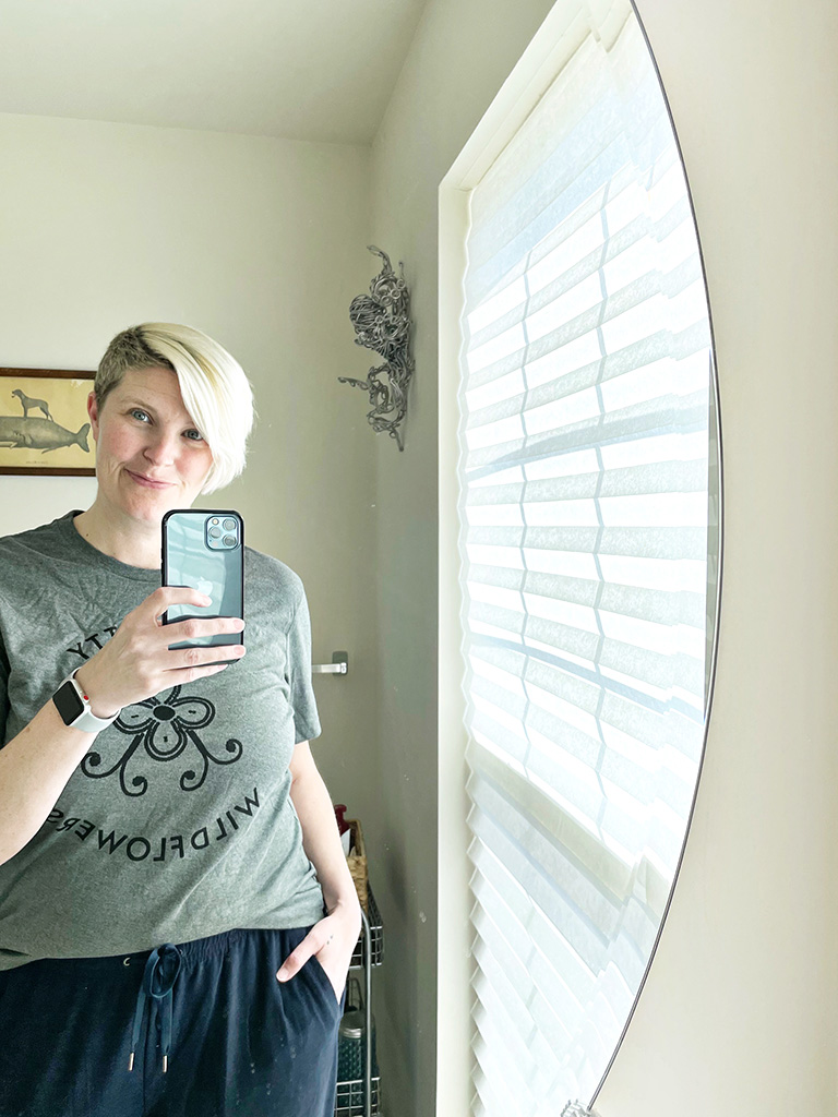 Author taking a self-portrait in mirror with iPhone